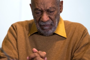 FILE - In this Nov. 6, 2014 file photo, entertainer Bill Cosby pauses during a news conference. Cosby's attorney said Sunday, Nov. 16, 2014 that Cosby will not dignify